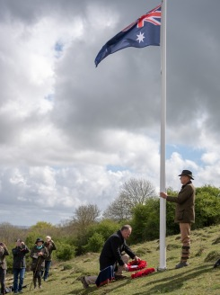 Mr Matt Anderson, the Deputy Australian High Commissioner paying tribute to the fallen by laying a wreath at the base of the flag pole. An ANZAC day service was held today in Wiltshire to commemorate the sacrifice made by the Australian Imperial Forces and remember their presence here in the County. The occasion also marked the formal opening of the restored chalk map of Australia. Guests included Mrs Sarah Troughton, the Lord Lieutenant of Wiltshire and Mr Matt Anderson, the Deputy Australian High Commissioner, Colonel Andrew Dawes, Commander South West and Lieutenant Colonel Ben Passmore, Australian Army UK Liaison Officer. We are also immensely privileged to be joined by Mrs Jill Young Who travelled from Australia to lay a wreath in memory of her father Albert Haslet, a Bombardier with the 12th Artillery Brigade, AIF, stayed at Hurdcott Camp between April and June 1918 recovering from wounds.